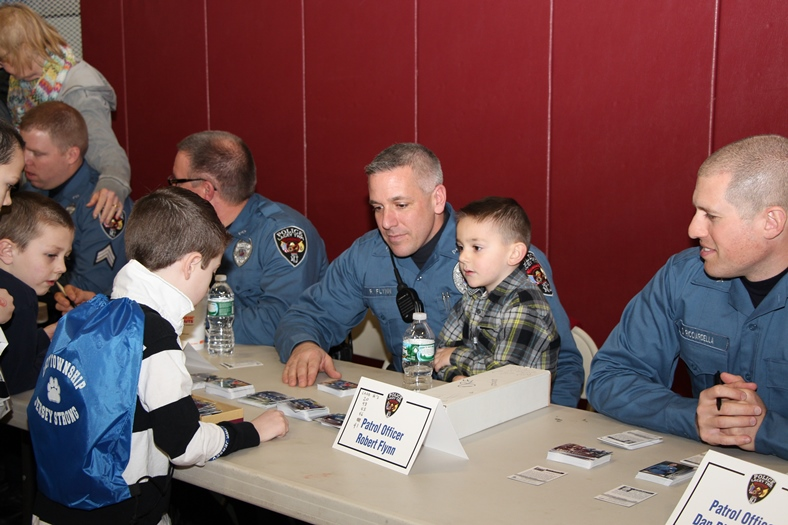 Officer Robert Flynn signing Cards at Meet-the-Officers Day 2014
