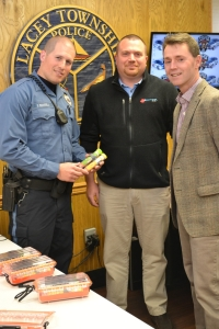 Officer Daniel Ricciardella with Dr. John Kulin, CEO of Urgent Care Now (Right) and James Jones, Marketing Director of Urgent Care Now (Middle).