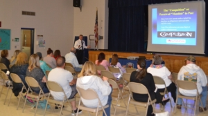 Chief David A. Paprota, Ed.D. conducting a social media presentation to parents.